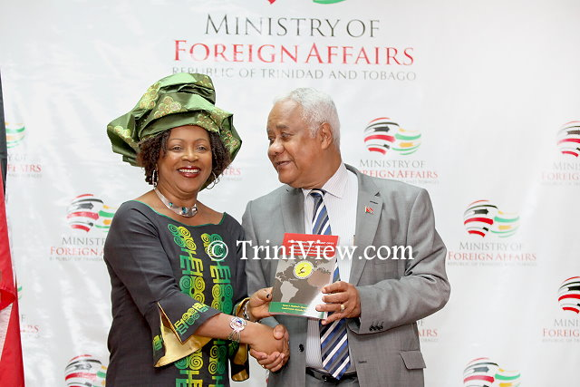 Dr. Verene Shepherd presents a copy of her book to to His Excellency Mervyn Assam