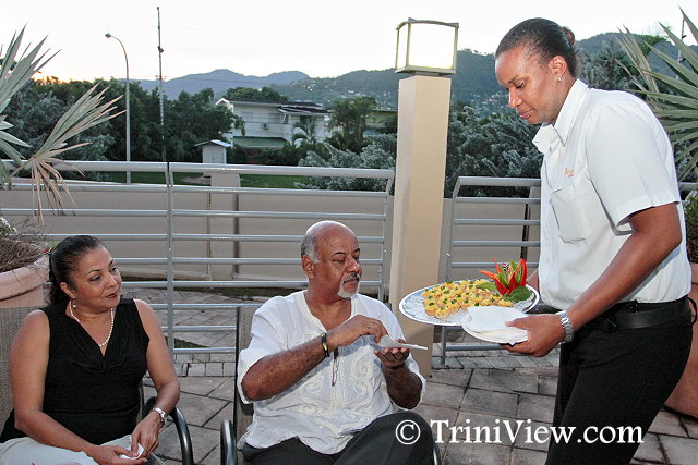 Wendy Imamashah and Paul Brathwaite being served at Party 67